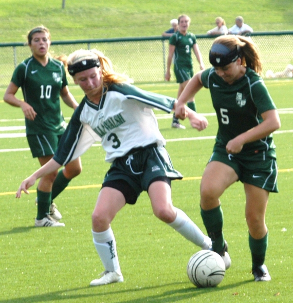 Villa Walsh's Megan Lawlor and Kinnelon's Brittany Boykus fight for control of the ball in a recent game.