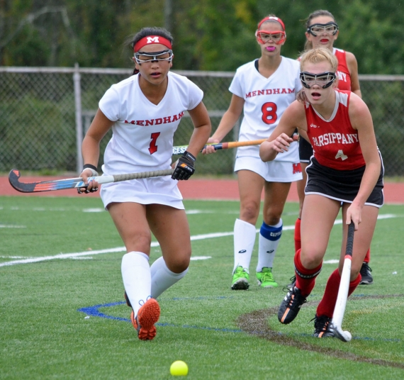 Mendham's Tara Litjens, left, and a Parsippany player pursue the ball.