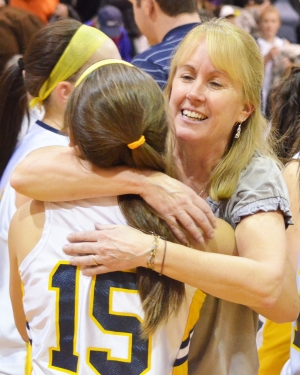 Pequannock coach Peggy Bionde embraces Kendall Machak after the Golden Panthers captured the sectional title.