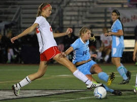 Jackie Reyneke of Northern Highlands leaps at the ball against Jessica Angle of West Morris.