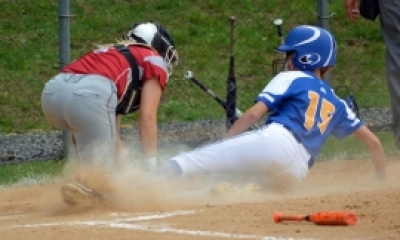 Butler's Melissa Konopinski slides safely into home, helping the Bulldogs to a win over Roselle Park.