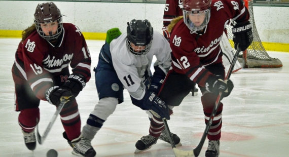Morristown-Beard's Keegan Heher, No. 19 on left, and teammate Kendall Cornine vie for control of the puck with The Hill School's Lexi Grippo.