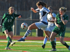 Randolph's Taylor Lusardi,center, muscles through the Kinnelon defense.