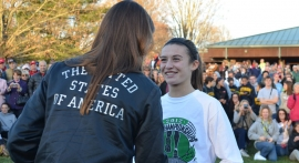 Sarah Disanza of High Point is congratulated by Olympian Julie Culley after winning the Meet of Champions.