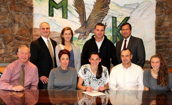 Kiki Baldassari, front row center, signs a letter of intent to play softball at Providence College. With Baldassari, front row, from left to right, are her grandfather, James Jacobson, mother, Kristin, father, Tony, and sister, Mia. In the back row, left to right, are Morris Knolls athletic director Ken Muller, teammate Tori Clarke, head softball coach Keith Heinemann and the principal, William Cleffi.