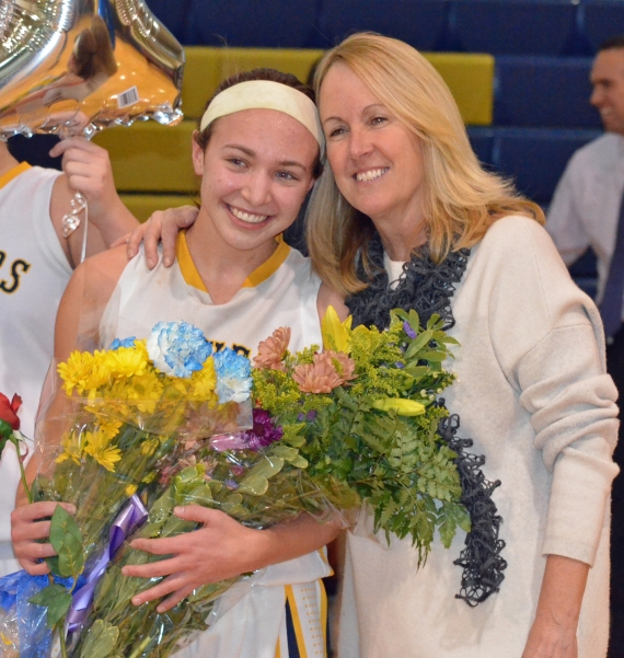 Pequannock's Carly Klimek poses with coach Peggy Bionde after scoring her 1,000th point. Klimek was one of the honorees at the MCGBCA luncheon.