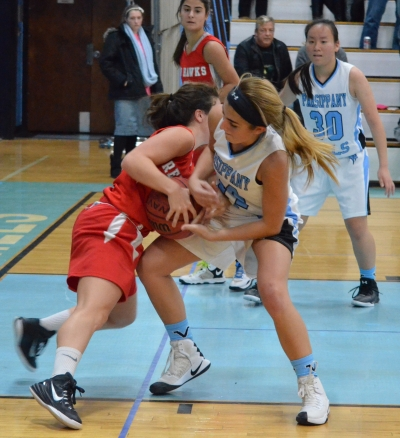 Parsippany Hills' Victoria Lombardi, right, battles a Parsippany player for the ball in non-conference action on Friday, Dec, 23.
