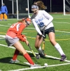 Parsippany's Sarah DiPippa, left, tries to move the ball as Parsippany Hills' Jillian Rogers defends.