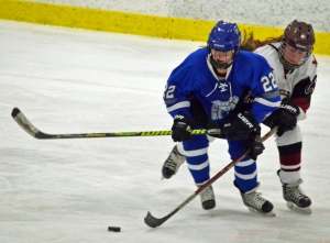 Morristown-Beard's Jenna Kurz, right, and Princeton Day's Caroline Haggerty go after the puck.