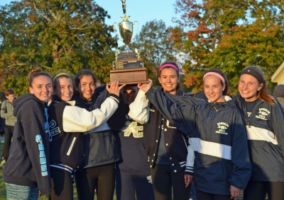 The Randolph girls cross country team displays its Morris County Cross Country Championships trophy.