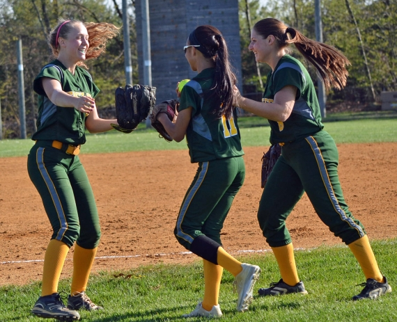Rachel Sweetser, left, and Allie Schey, right, congratulate Danica Lee on her diving catch.