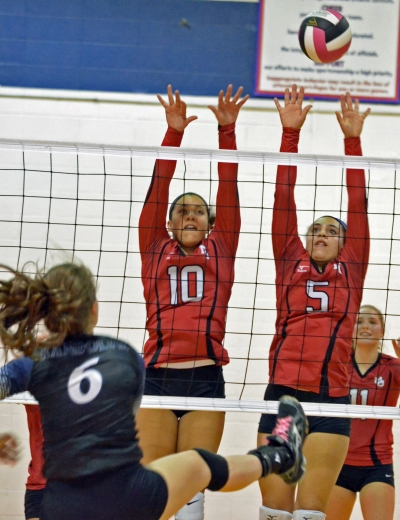 Mackenzie Laidlaw and Adriana Garcia of Mount Olive go up to block during the 2017 MCT final. No. 6 is Randolph's Caileigh Cox.