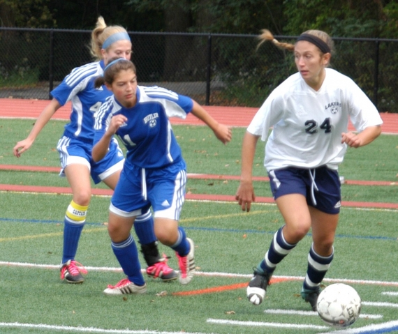 Mountain Lakes' Jackie Perry controls the ball. Butler's Toni DiFranco, No. 11, is in pursuit.