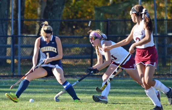 Pequannock's Lauren Burklow fights for control of the ball with Pompton Lakes' Harlee York as Amanda Fermin looks on.