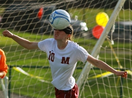 Madison's Rebecca Levin heads the ball.