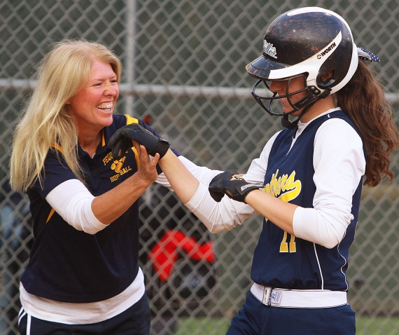 Pequannock coach Maryann Goodwin, who got her 300th career win on Saturday, April 14, congratulates Kayla Lombardo as she rounds third base during the 2011 MCSCA Senior All-Star Game. Goodwin reached the milestone win against Mount St. Dominic.