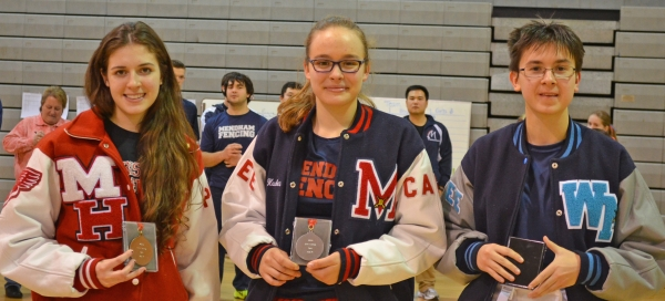 Katherine Santsevich of West Morris, on right, was first in epee at the Morris County Girls Fencing Championships. Jackie Lanigan of Morris Hills was third and Emma Hawkes of Mendham took second.