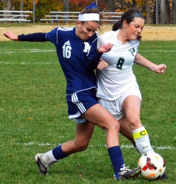 Kinnelon's Casey Gray, right, and a Mountain Lakes player vie for control of the ball.