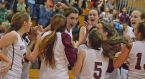 Morristown's Abby Schubiger, third from left, and her teammates celebrate her 1,000th career point.