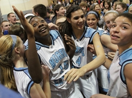 Sade Idera, No. 10, celebrates with her teammates after Morris Catholic won the Morris County Tournament championship on Friday, Feb. 22.