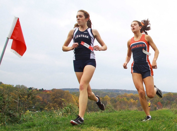 Tara Hanley of Chatham and Colette Richter of Mountain Lakes at the halfway point of the NJAC Small Schools Race.