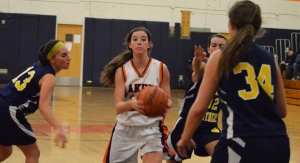 Mountain Lakes' Katie Reese tries to penetrate the Pequannock defense