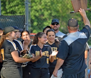 Hanover Park coach Jamie Galioto shows the trophy to his team after it defeated Parsippany for the sectional title.