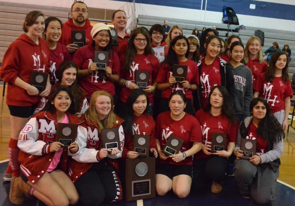 The members of the Morris Hills High School girls fencing team pose after winning the team title at the Morris County Championships.