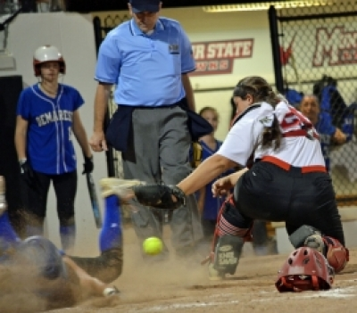 The ball got away from Parsippany catcher Sarah Waffenfeld on a play at the plate.