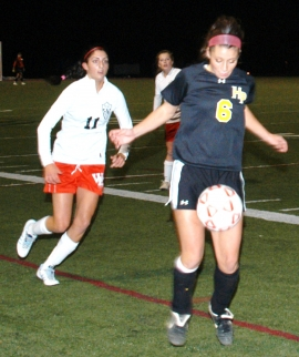 West Essex&#039;s Brianna Panico closes in on Christina LoConte of Hanover Park.