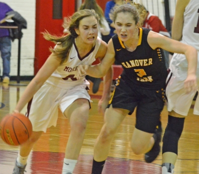 Elizabeth Strambi of Morristown tries to dribble past Hanover Park's Kelsey Stites in the final of the Morris Hills Holiday Tournament.