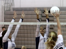 Gabriella Savite and Alexa Mataczynski of West Morris go up for a block against Randolph's Nikki Backer.