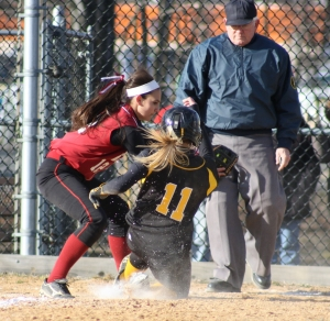 Hanover Park's Morgan Battito slides safely into home, just ahead of the tag by Whippany Park pitcher Jenn Sanislo.