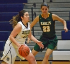 Lydia Musmanno of Roxbury, left, dribbles past Morris Knolls' Becca Fair.