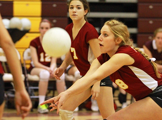 Madison's Margy Taylor gets set to return a serve.