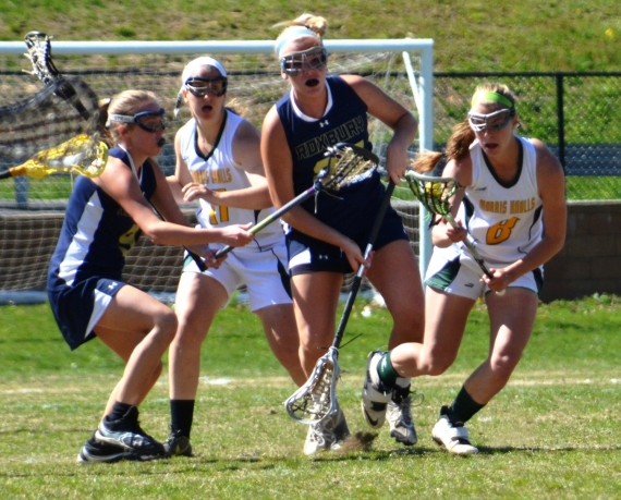 Morris Knolls&#039; Jacie Cooper, right, tries to elude Roxbury defenders Amanda Beal and Katie Cikovsky.
