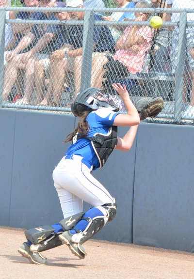 Bulldogs catcher Kayla Carr pursues a popup on the Group I final.