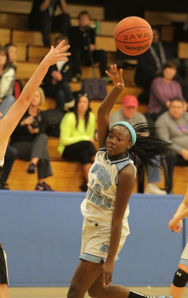 Sade Idera of Morris Catholic makes  pass during a game earlier this season.