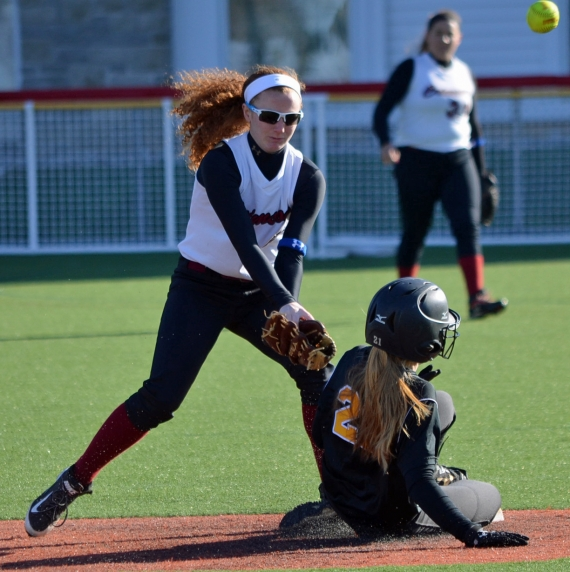In the slideshow, Hanover Park's Brittany Monahan fields the grounder that will produce the final out. The ball gets away from the Crimson's Sara Sueffert as she tries to apply a tag at second base,