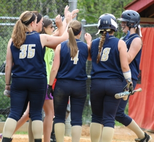 Roxbury players congratulate Holly Arentowicz, far right, after her third-inning home run.