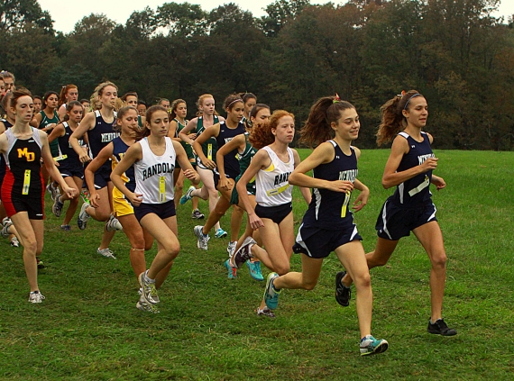 Mendham's MacKenzie Barry, front left, is all smiles as she leads the pack at the start.