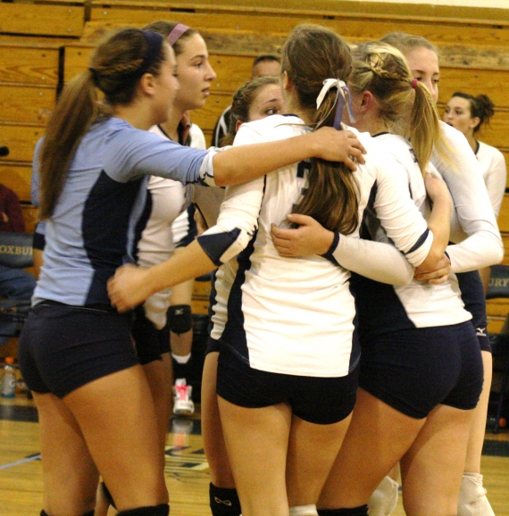 West Morris, shown in a huddle, defeated Madison, 25-20, 25-20.