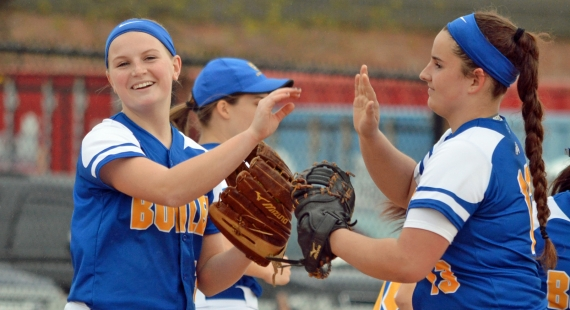 First baseman Kellie Faber, right, congratulates pitcher Larissa Spellman on one of her 18 strikeouts.