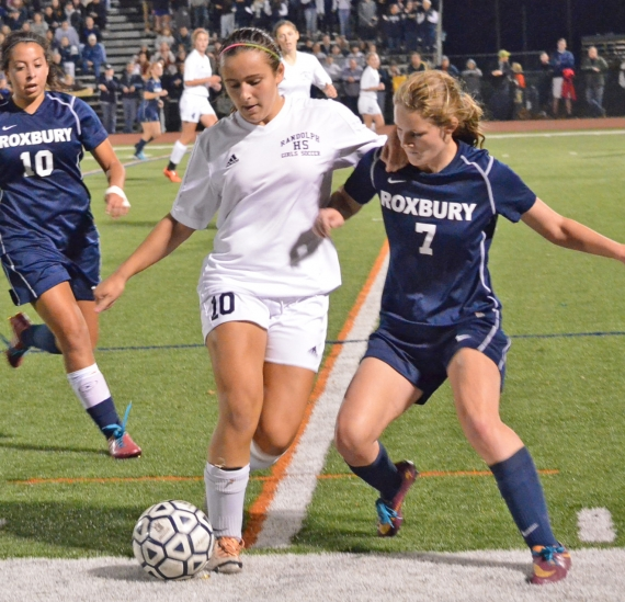 In the slideshow, Randolph players celebrate Katja Brackelmanns-Puig's goal with 10:06 remaining in regulation. In photo above, players battle for control of the ball.