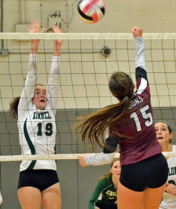 Kinnelon's Alexa Monro goes up for a block.