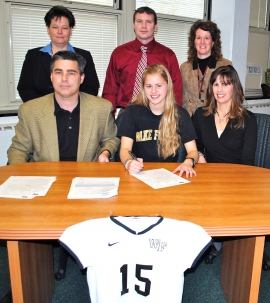 Krysta Wangerin, front center, signs her letter of intent. Flanking Wangerin are her parents. Standing, left to right, are Boonton principal Jacalyn Richardson, athletic director David Hughen and field hockey coach Deb Ballway.