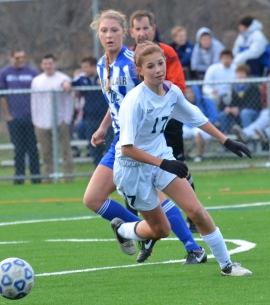 Esther Wellman of Randolph races to the ball while being pursued by a Montclair defender.