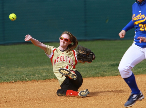 Mount Olive shortstop Cathy Drury throws out a runner at third base.