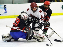 A Morristown-Beard player, in white jersey, tries to get the puck past the Quarry Cats' goalie earlier this season.
