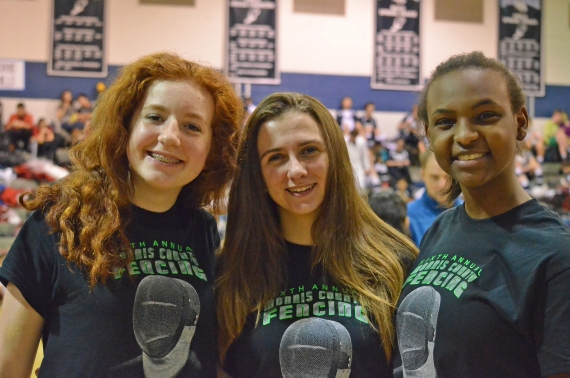 Rachel Davitt, Chana Hancox and Bailey Speight pose for a photo after taking first in epee at the Morris County Championships.
